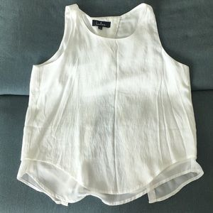 White sleeveless blouse with open back